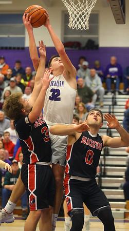 2-11-20<br /> Northwestern vs Blackford boys basketball<br /> NW's Eli Edwards pulls down the rebound.<br /> Kelly Lafferty Gerber | Kokomo Tribune