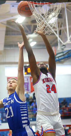 2-8-20<br /> Basketball Day-Kokomo vs Tipton<br /> Kokomo's R.J. Oglesby and Tipton's Dalton Money go for a rebound.<br /> Kelly Lafferty Gerber | Kokomo Tribune