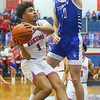 2-8-20<br /> Basketball Day-Kokomo vs Tipton<br /> Kokomo's Savion Barrett puts up a shot as Tipton's Sam Ridgeway puts up a block.<br /> Kelly Lafferty Gerber | Kokomo Tribune