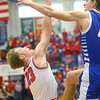 2-8-20<br /> Basketball Day-Kokomo vs Tipton<br /> Kokomo's Jackson Richards puts up a shot over Tipton's Sam Ridgeway's block.<br /> Kelly Lafferty Gerber | Kokomo Tribune
