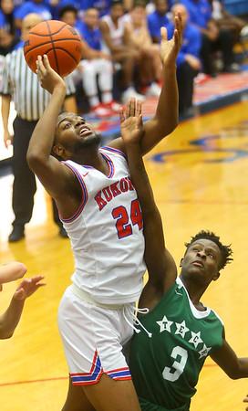 2-6-20<br /> Kokomo vs Arsenal Tech boys basketball<br /> Kokomo's R.J. Oglesby puts up a shot.<br /> Kelly Lafferty Gerber   Kokomo Tribune