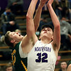2-13-21<br /> Eli Edwards gets pressure from behind from Evan Monize as Northwestern defeats Eastern in Saturday evenings boys basketball matchup 49-44.<br /> Tim Bath | Kokomo Tribune