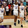 2-13-21<br /> Quentin Yeakel, Mario Reed and Eli Edwards cheer after Northwestern defeats Eastern in Saturday evenings boys basketball matchup 49-44.<br /> Tim Bath | Kokomo Tribune