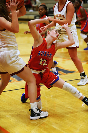 2-5-21<br /> Brooke Hughes is not able to hold onto the ball on a drive through Kokom girls loose to McCulcheon in Friday evenings sectional basketball match up in West Lafayette.<br /> Tim Bath | Kokomo Tribune