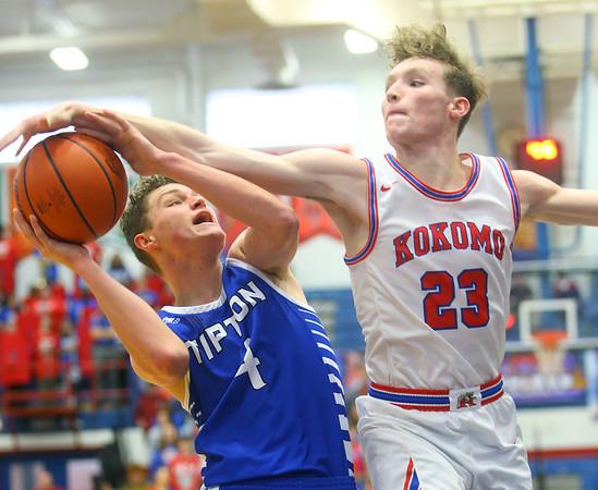 2-8-20<br /> Basketball Day-Kokomo vs Tipton<br /> Kokomo's Jackson Richards puts up a block to Tipton's Noah Wolfe.<br /> Kelly Lafferty Gerber   Kokomo Tribune