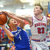 2-8-20<br /> Basketball Day-Kokomo vs Tipton<br /> Kokomo's Jackson Richards puts up a block to Tipton's Noah Wolfe.<br /> Kelly Lafferty Gerber | Kokomo Tribune