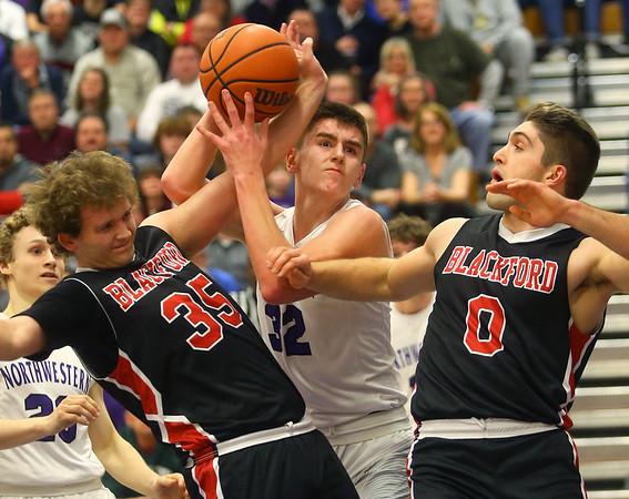 2-11-20<br /> Northwestern vs Blackford boys basketball<br /> NW's Eli Edwards is fouled after grabbing the rebound.<br /> Kelly Lafferty Gerber | Kokomo Tribune