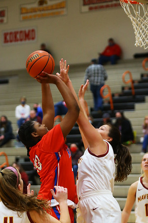 2-5-21<br /> Aijia Elliott shooting over Daylynn Thornton as Kokom girls loose to McCulcheon in Friday evenings sectional basketball match up in West Lafayette.<br /> Tim Bath | Kokomo Tribune