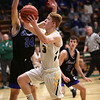 2-25-21<br /> Levi Mavrick takes the ball in for 2 points as Eastern HS defeats Carroll 64-53 on Thursday.<br /> Tim Bath | Kokomo Tribune