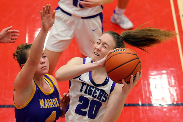 Leah Carter rebounding in the second half of girls sectional basketball at Logansport between Northwestern and Marion HS on February 7, 2020.<br /> Tim Bath   Kokomo Tribune