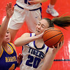 Leah Carter rebounding in the second half of girls sectional basketball at Logansport between Northwestern and Marion HS on February 7, 2020.<br /> Tim Bath | Kokomo Tribune