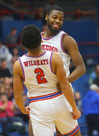 2-8-20<br /> Basketball Day-Kokomo vs Tipton<br /> R.J. Oglesby celebrates with Ta'Shy Stewart after the Wildkats beat the Blue Devils.<br /> Kelly Lafferty Gerber | Kokomo Tribune