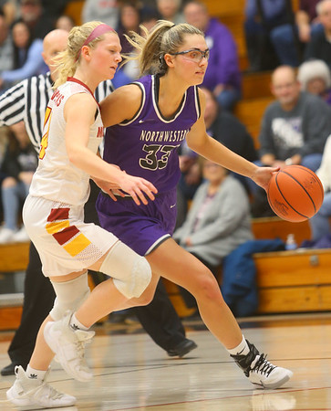 2-8-20<br /> Northwestern vs McCutcheon girls basketball sectional championship <br /> Madison Layden takes the ball down the court.<br /> Kelly Lafferty Gerber | Kokomo Tribune