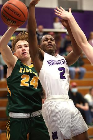 2-13-21<br /> Zarson Stiner fouls Mario Reed giving him 2 shots at the line as Northwestern defeats Eastern in Saturday evenings boys basketball matchup 49-44.<br /> Tim Bath   Kokomo Tribune