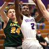 2-13-21<br /> Zarson Stiner fouls Mario Reed giving him 2 shots at the line as Northwestern defeats Eastern in Saturday evenings boys basketball matchup 49-44.<br /> Tim Bath | Kokomo Tribune
