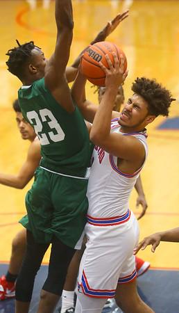 2-6-20<br /> Kokomo vs Arsenal Tech boys basketball<br /> Kokomo's Savion Barrett is fouled at the basket.<br /> Kelly Lafferty Gerber | Kokomo Tribune