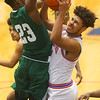 2-6-20<br /> Kokomo vs Arsenal Tech boys basketball<br /> Kokomo's Savion Barrett is fouled at the basket.<br /> Kelly Lafferty Gerber | Kokomo Tribune