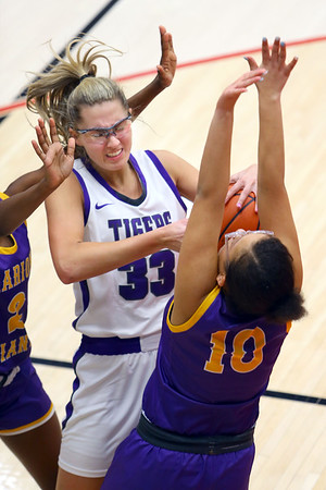Madison Layden pulls down a rebound in the second half of sectional basketball at Logansport between Northwestern and Marion HS on February 7, 2020.<br /> Tim Bath | Kokomo Tribune