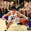 2-13-21<br /> Quentin Yeakel loses control of the ball and draws a foul from Cayden Calloway as Northwestern defeats Eastern in Saturday evenings boys basketball matchup 49-44.<br /> Tim Bath | Kokomo Tribune