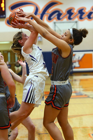2-5-21<br /> Ellie Boyer experiences pressure from Campbell Moore as Northwestern girls loose to Harrison in Friday evenings sectional basketball match up in West Lafayette.<br /> Tim Bath | Kokomo Tribune