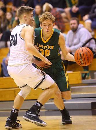 1-25-20<br /> Western vs Eastern boys basketball<br /> Eastern's Brayden Richmond takes the ball down the court.<br /> Kelly Lafferty Gerber | Kokomo Tribune