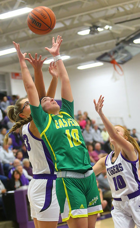 1-8-20<br /> Northwestern vs Eastern girls basketball<br /> Eastern's McKenzie Cooper, Northwestern's Madison Layden and Klair Merrell go after a rebound.<br /> Kelly Lafferty Gerber | Kokomo Tribune