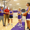 Head coach Kathie Layden, left, addresses the team as her husband Jeff, daughter McKenna, senior player Klair Merrell, and daughter Madison, listen in alongside the rest of the team.<br /> Kelly Lafferty Gerber | Kokomo Tribune