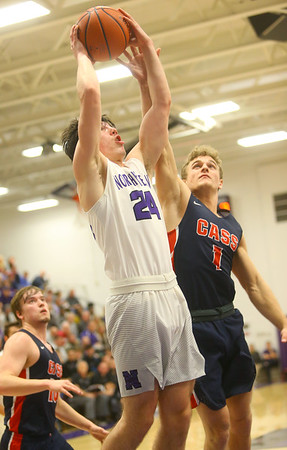 1-24-20<br /> Northwestern vs Cass boys basketball<br /> NW's Mason Estle puts up a shot.<br /> Kelly Lafferty Gerber | Kokomo Tribune