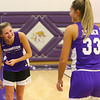 Freshman McKenna Layden laughs with her sister, senior Madison Layden, during practice on Oct. 29.<br /> Kelly Lafferty Gerber | Kokomo Tribune