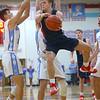 1-31-20<br /> Maconaquah vs Cass boys basketball<br /> Cass' Gabe Eurit jumps as he makes a pass.<br /> Kelly Lafferty Gerber | Kokomo Tribune