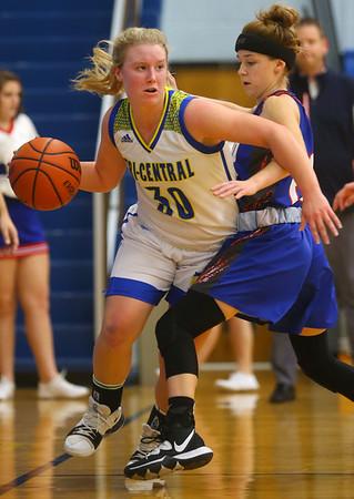 1-22-20<br /> Tri Central vs Elwood girls basketball<br /> Tri Central's Gracie Grimes looks for a pass.<br /> Kelly Lafferty Gerber   Kokomo Tribune