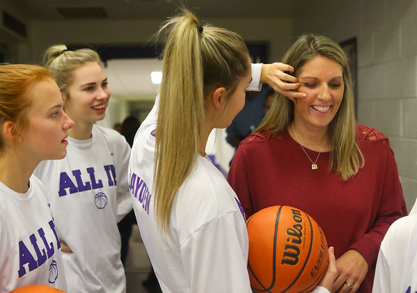 Senior Madison Layden helps wipe makeup off her mom, Kathie Layden, as the team takes a breather while they wait in the wings of the Tigers' gym after shedding tears during senior day for the Northwestern Tigers on Jan. 11.<br /> Kelly Lafferty Gerber | Kokomo Tribune
