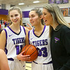 Madison Layden, center gets a hug from her sister McKenna, and mom Kathie Layden after Madison scored her 2,000th point on Jan. 8.<br /> Kelly Lafferty Gerber | Kokomo Tribune