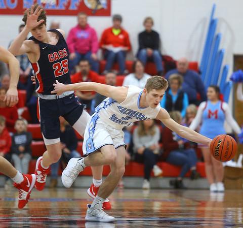 1-31-20<br /> Maconaquah vs Cass boys basketball<br /> Mac's Nolan Kelly grabs a loose ball and heads down the court.<br /> Kelly Lafferty Gerber | Kokomo Tribune