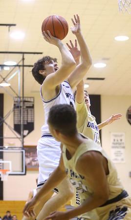 1-3-20<br /> Western vs Oak Hill boys basketball<br /> Western's Kace Howard is fouled as he makes a basket.<br /> Kelly Lafferty Gerber | Kokomo Tribune