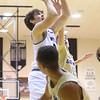 1-3-20<br /> Western vs Oak Hill boys basketball<br /> Western's Kace Howard is fouled as he makes a basket.<br /> Kelly Lafferty Gerber   Kokomo Tribune