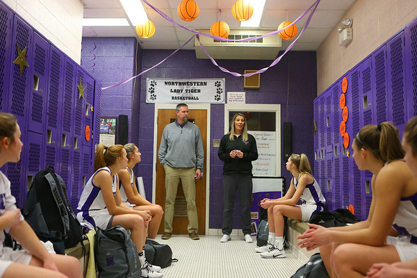 Head coach Kathie Layden, right, and her husband, assistant coach Jeff Layden, address the team in the locker room during halftime of a home game on Jan. 8.<br /> Kelly Lafferty Gerber | Kokomo Tribune