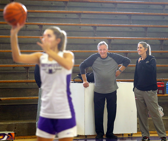 Dave Wise, assistant coach, chats with his daughter Kathie Layden, head coach, as they watch Madison Layden, Kathie's daughter and Dave's granddaughter, shoot free throws during practice on Dec. 6.<br /> Kelly Lafferty Gerber | Kokomo Tribune