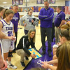 Head coach Kathie Layden talks to the players at the bench before the start of the game on Dec. 10. Surrounding Kathie include her dad, assistant coach Dave Wise, and her husband, assistant coach Jeff Layden.<br /> Kelly Lafferty Gerber | Kokomo Tribune