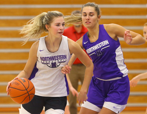 Madison Layden, right, plays defense on her little sister, McKenna Layden, during a drill at practice on Oct. 29.<br /> Kelly Lafferty Gerber | Kokomo Tribune