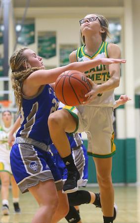 1-14-20<br /> Eastern vs Tipton girls basketball<br /> Eastern's Lexi James is fouled at the basket by Tipton's Olivia Spidel.<br /> Kelly Lafferty Gerber | Kokomo Tribune