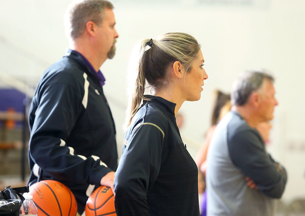 Head coach Kathie Layden, center, watches practice on Dec. 6 with assistant coaches, Jeff Layden, left, her husband, and Dave Wise, right, her dad. <br /> Kelly Lafferty Gerber | Kokomo Tribune