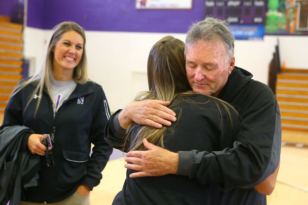 Dave Wise hugs his granddaughter Madison Layden as Madison's mom and Dave's daughter, Kathie Layden looks on after Madison officially signed with Purdue on signing day at Northwestern High School on Nov. 13.<br /> Kelly Lafferty Gerber | Kokomo Tribune