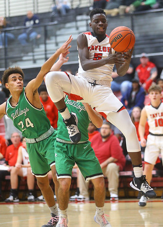 1-17-20<br /> Taylor vs CC boys basketball<br /> Taylor's Toric Spires grabs a rebound.<br /> Kelly Lafferty Gerber | Kokomo Tribune