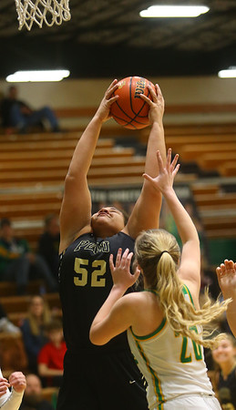1-30-20<br /> Eastern vs Peru girls basketball<br /> Peru's Kelsie Kelley grabs a rebound.<br /> Kelly Lafferty Gerber | Kokomo Tribune