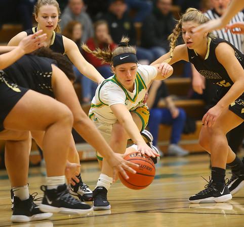 1-30-20<br /> Eastern vs Peru girls basketball<br /> Eastern's McKenzie Cooper goes after a loose ball.<br /> Kelly Lafferty Gerber | Kokomo Tribune