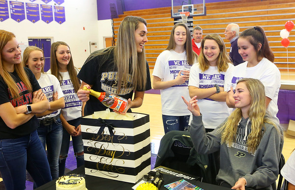Madison Layden, left, jokes with her sister McKenna Layden as Madison opens a gift from McKenna on signing day, when Madison offically signed with Purdue on Nov. 13.<br /> Kelly Lafferty Gerber | Kokomo Tribune