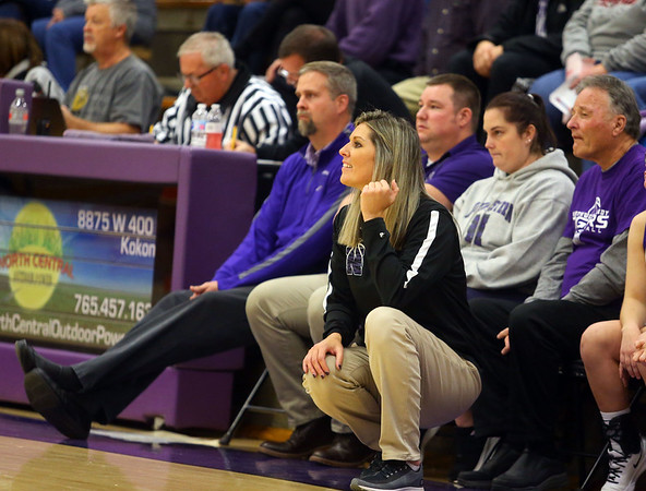 Northwestern girl's basketball head coach Kathie Layden, center, coaches the girls in a game on Dec. 10. One of Kathie's assistant coaches is her husband, Jeff, sitting on the far left of the bench, and her dad, Dave Wise, sitting on the right end.<br /> Kelly Lafferty Gerber | Kokomo Tribune