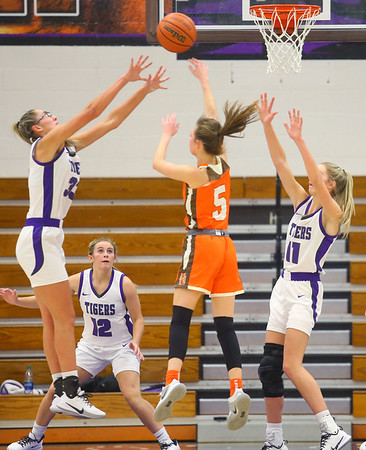 "6'1"" sisters Madison Layden, left, and McKenna Layden put up a block on a Hamilton Heights player during a game on Dec. 10.<br /> Kelly Lafferty Gerber 