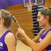 Madison Layden, right, braids her sister McKenna Layden's hair during basketball practice on Dec. 17.<br /> Kelly Lafferty Gerber | Kokomo Tribune